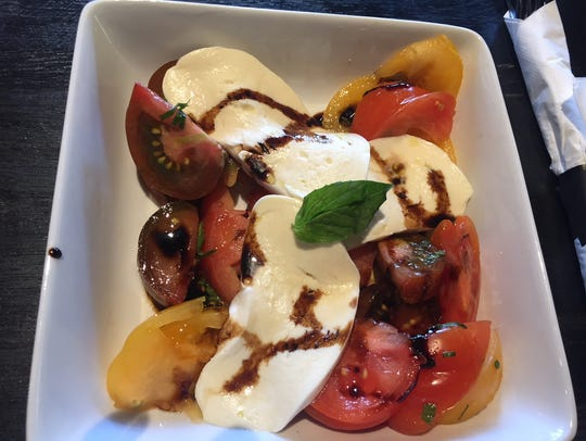 A seasonal appetizer of house-made mozzarella with