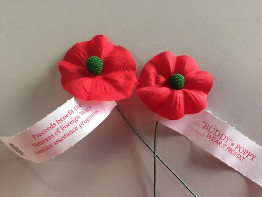 """A pair of Veterans of Foreign Wars """"Buddy Poppies."""""""