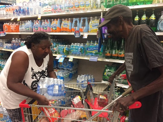 Charleston Park resident Linda Francis, left, shops with former Charleston Park resident, Willie McGee last year. Francis checked in on and helped McGee with transportation and other issues.