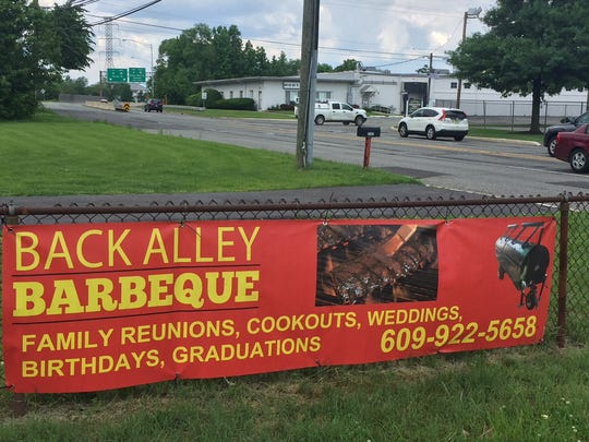 Until a permanent sign is erected this temporary banner along Haddonfield-Berlin Road in Pennsauken advertises the new Back Alley Barbeque operated by a local resident