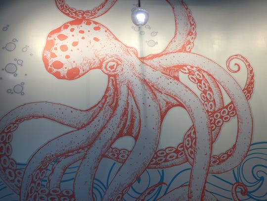 A giant octopus greets guests of The Marketplace at
