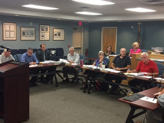 The Canandaigua Town Board met July 16, 2018, to fine its supervisor, Greg Westbrook, center, $250 for a fire hydrant on his property that was improperly accessed.