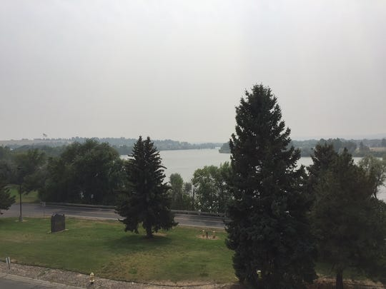 Smokes hangs over the Missouri River and Great Falls