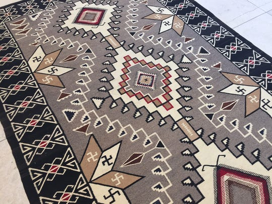 This 6-foot-by-9-foot rug from Teec Nos Pos, dating