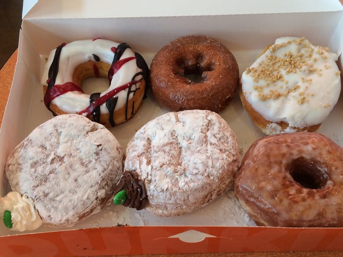 Donuts, from top left clockwise: Cardinals Donut, Pumpkin,