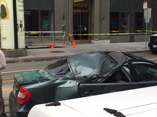 A window washer fell 11 stories from a building in