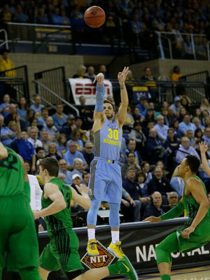Marquette guard Andrew Rowsey hits an early three-point shot during the first period against Oregon.