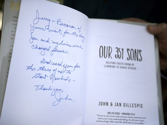 "John Gillespie, founder of Rawhide Boys Ranch, wrote a note to Jerry Monson, the first Rawhide boy, inside a copy of Gillespie's book, ""Our 351 Sons."" ""Jerry, Because of your visit, for the day, Jan and my lives were changed forever. God used you for the three of us to start Rawhide."""