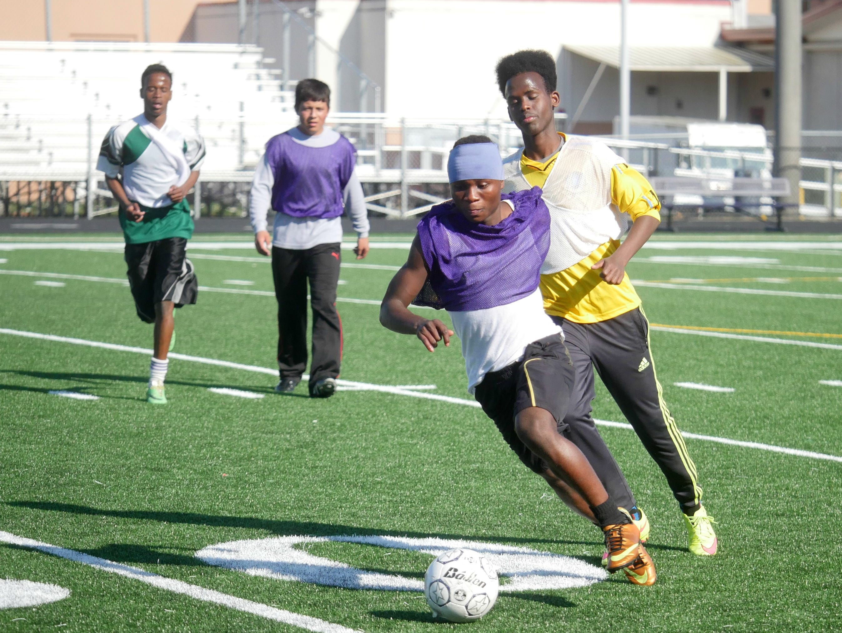 Foster's Desire Katameya dribbles down the field during a scrimmage at practice.