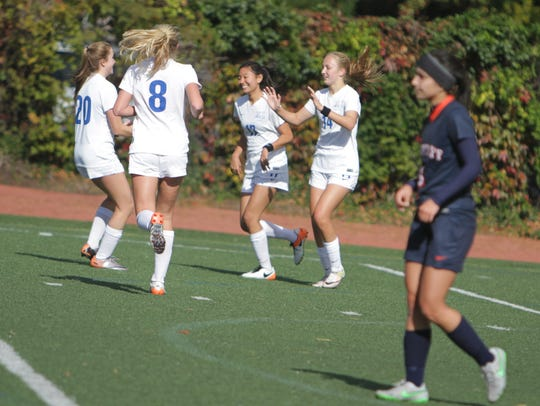 Bronxville celebrates after a goal from Rachael Peacock