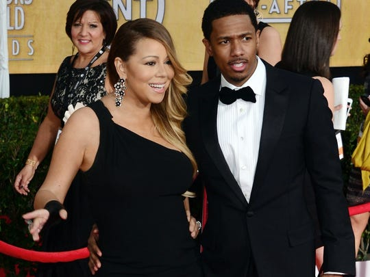 """(FILES) Singer Mariah Carey and husband Nick Cannon attend the 20th annual Screen Actors Guild Awards in this January 18, 2014, file photo at the Shrine Auditorium in Los Angeles. Media, on August 21, 2014, reported that the couple separated back in May 2014 and are seeking a divorce. Celebrity news internet magazine TMZ cited """"sources connected to the couple"""" saying Carey and Cannon have been living in seperate houses in New York.   AFP PHOTO / FREDERIC J. BROWN / FILESFREDERIC J. BROWN/AFP/Getty Images"""