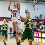 Marshall's Emily Delmotte (21) goes for the basket against Pennfield's Brooke Lenz (20) Friday evening.