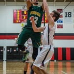 Pennfield's Steffen Kinne (12) goes to the basket against Marshall on Friday.