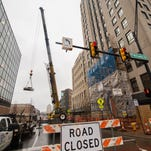 West Michigan Avenue was blocked off on Wednesday as stone plates were removed from the front of the Battle Creek Tower as part of a restoration project.