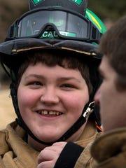 Tecumseh Middle School student Gavin Darrah, 14, prepares