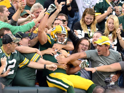 Green Bay Packers reciever Jeff Janis (83) celebrates his touchdown catch in the stands against the Kansas City Chiefs at Lambeau Field.