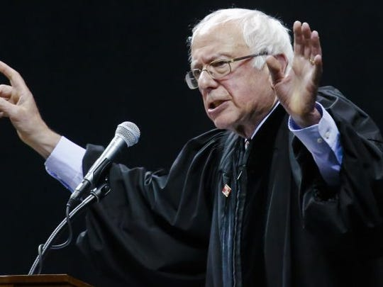 Vermont Sen. Bernie Sanders addresses Brooklyn College graduates during their commencement ceremony, Tuesday, May 30, 2017, in New York. The former Democratic presidential candidate, who hails from Brooklyn and attended the school for a year, urged graduates to stand together and not let demagogues divide the country.