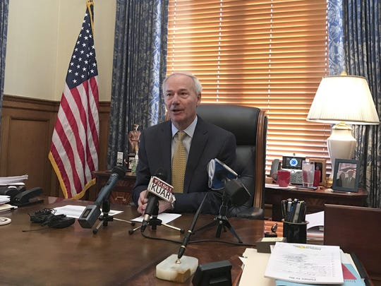 Gov. Asa Hutchinson speaks to reporters at the State Capitol in this file photo.