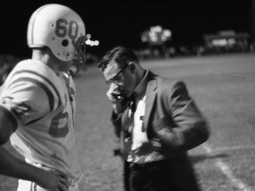 Gene Cox, seen here in 1965, was a coaching legend for the state of Florida, winning state titles in 1969 and 1974 and retiring in 1990 as the all-time winningest coach. He died on March 30, 2009. Capital Stadium was renamed in his honor in 1998.