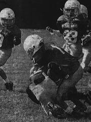 Ryan Ramczyk tackles his opponent during a Youth Area