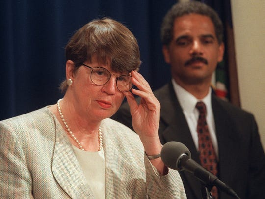 Attorney General Janet Reno, accompanied by Deputy Attorney General Eric Holder, meets reporters at the Justice Department in Washington  Aug. 4, 1998. Both approved the DEA phone data collection, according to a Justice Department letter sent to Sprint executives that year.