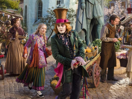 "Mia Wasikowska and Johnny Depp star in ""Alice Through the Looking Glass."""