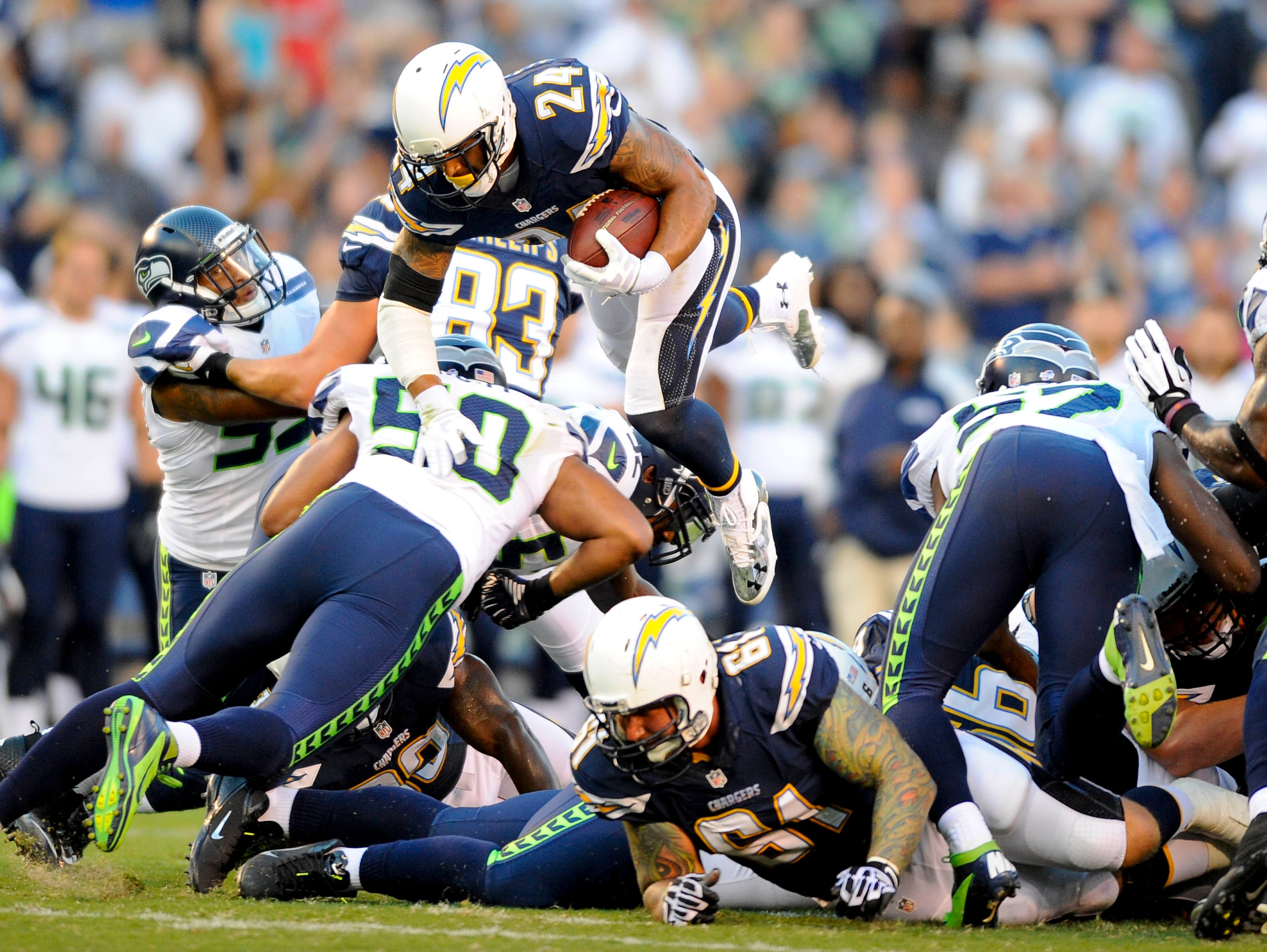 San Diego Chargers running back Ryan Mathews (24) jumps over the line for a first down during the first half against the Seattle Seahawks at Qualcomm Stadium.