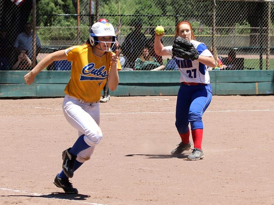 Cassadee McNulty of Durham looks to throw out Anderson's Chelsea Reeder at first during Saturday's Lions All-Star softball game in Chico. The South team beat the North 12-7.