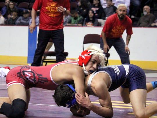 Cobre's Isaiah Marquez locks the front head of his