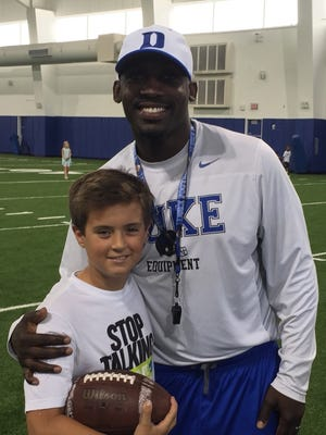 Miller Waid takes picture with Duke offensive coordinator Scottie Montgomery at David Cutcliffe QB College last week at Duke University.