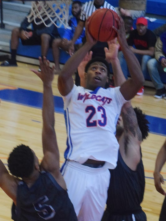 Louisiana College's Steve Evans (23) goes for two over University of Texas at Tyler defenders.