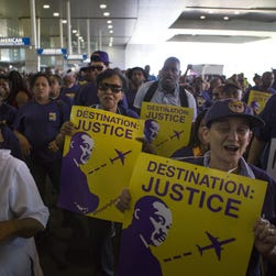 Philadelphia International Airport workers hold a rally July 19 for a $15 an hour minimum wage. They plan to strike next week during the Democratic National Convention to call attention to their demands for higher pay and union representation.