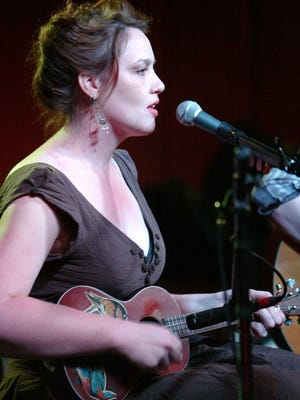 """Jillian Johnson sings and plays at Grant Street Dancehall in this 2010 photo. Johnson's music will be part of a forthcoming CD, """"Lafayette Healing."""""""