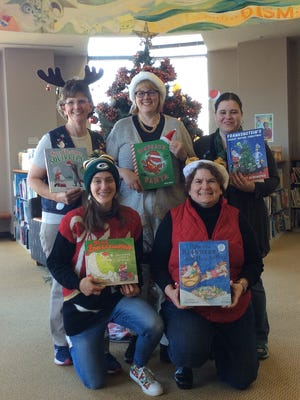 Children's Services staff at Manitowoc Public Library: Back row, from left: Betty Schwede, Susan Menk and Lisa Pike; and front row, from left: Julia Lee and Lynn Christiansen.