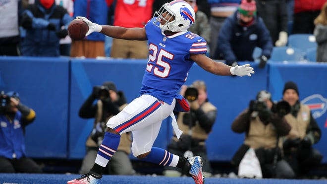 Bills running back LeSean McCoy scores one of his two first half touchdowns against the Dolphins.