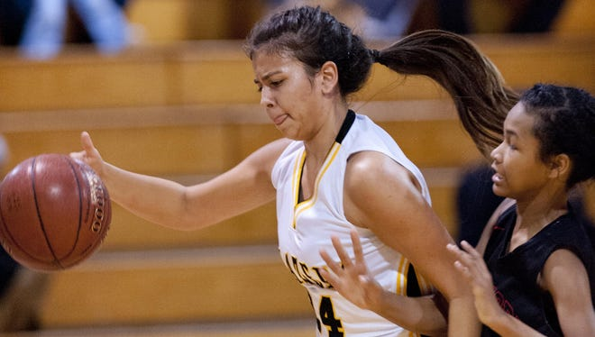 Golden West's Mia Moreno stays ahead of Hanford's Anajah Gifford in a WYL game on Tuesday. The Trailblazers will host the Golden West Shootout on Saturday at Golden West.