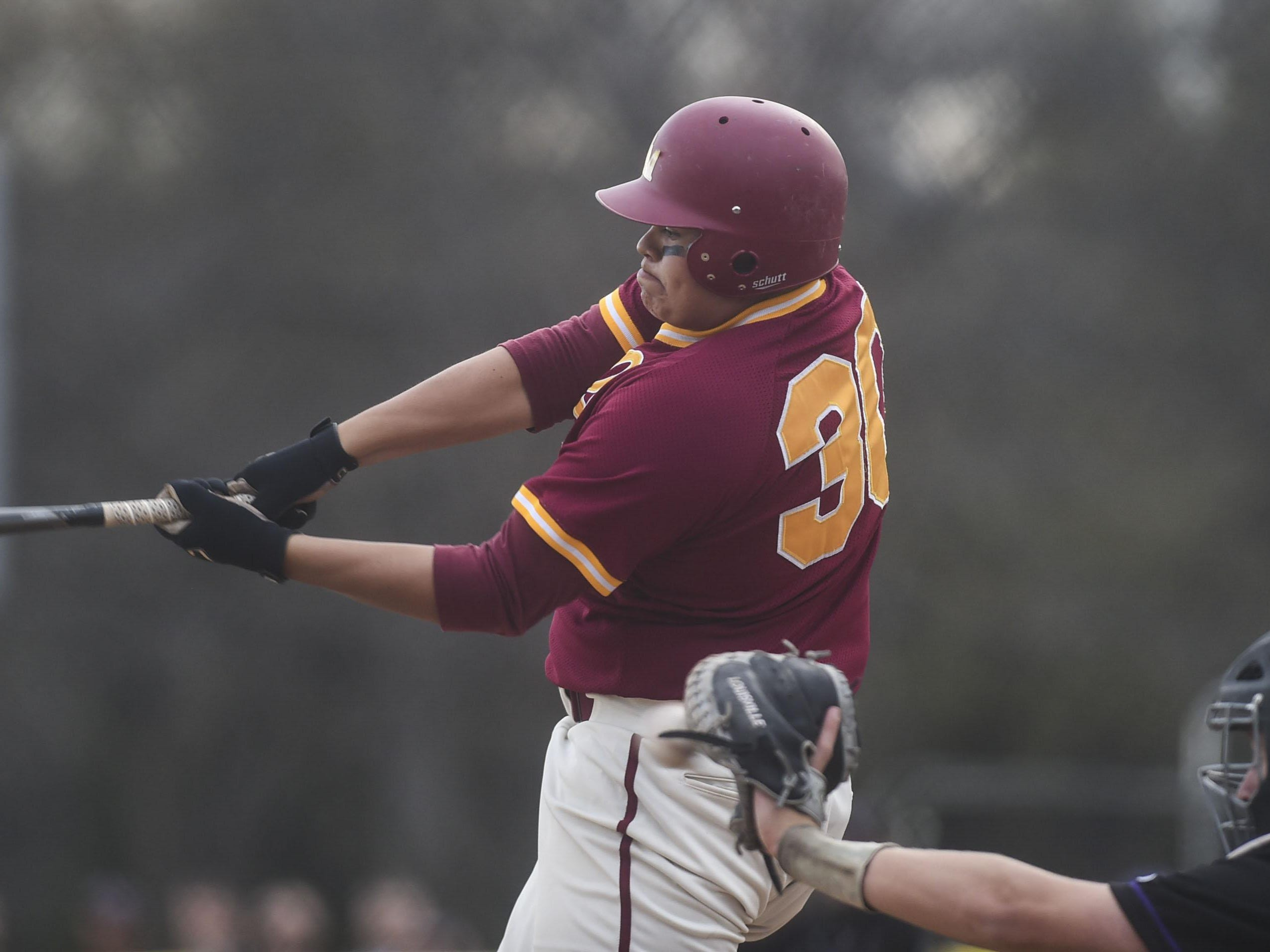 Rocky Mountain's Austin Alarid swings at a pitch in a game last season. The Lobos are ranked No. 5 in Class 5A.