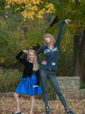 Country star Taylor Swift poses with 8-year-old lucky fan  Anna Grace Farner during photographer Brooke Rainey's photoshoot at Percy Warner Park.
