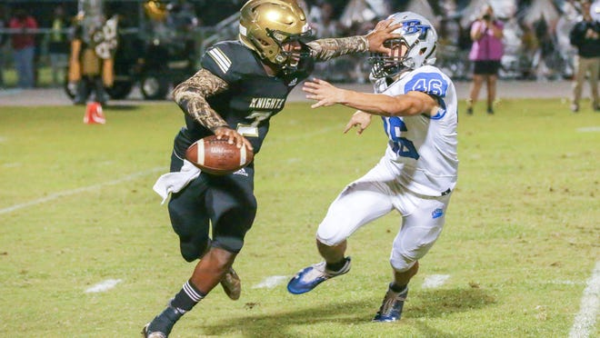 Oakleaf quarterback Walter Simmons III stiff-arms a Bartram Trail tackler in 2019. The Knights and Bears face off again Friday night.