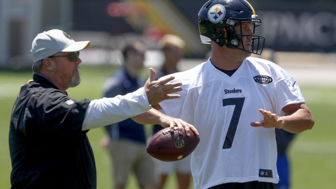 "FILE - In this June 11, 2019, file photo, Pittsburgh Steelers quarterback Ben Roethlisberger (7) throws as offensive coordinator Randy Fichtner watches during practice in Pittsburgh. Fichtner has a message for players who think everything will be easy now that star quarterback Ben Roethlisberger has returned from an elbow injury that limited him to two games in 2019. ""Don't think that maybe I can take a deep breath and say, 'Ah, Ben's back,' "" Fichtner said Wednesday. ""That's not the case. That's not going to be the charge."""