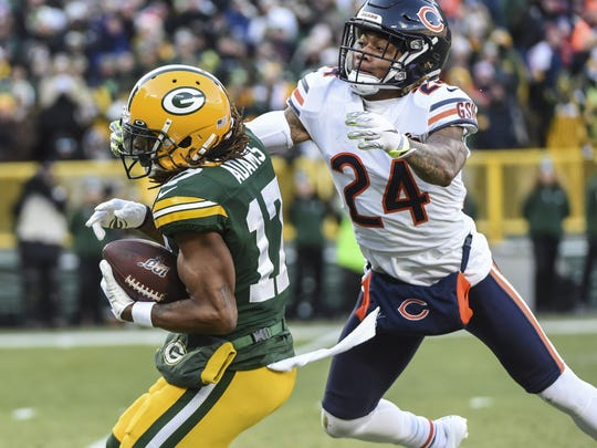 Dec 15, 2019; Green Bay, WI, USA;  Green Bay Packers wide receiver Davante Adams (17) catches a touchdown pass against Chicago Bears cornerback Buster Skrine (24) in the first quarter at Lambeau Field. Mandatory Credit: Benny Sieu-USA TODAY Sports