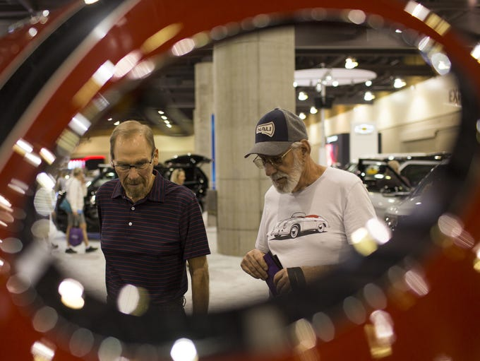 Eric Kuhnhausen (left) and Jack Flowers look at a Mini
