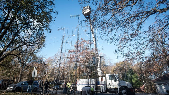 A bucket truck was brought to Coleman Park to help upright the largest display, a lighted castle that is about 25 feet high and 35 feet wide.