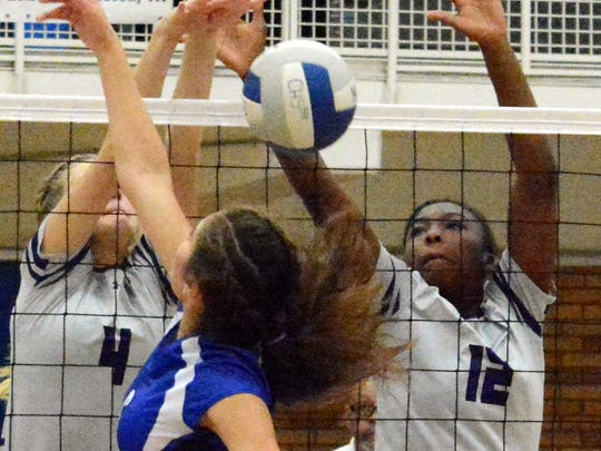 Clovis' Lexi Cole (4) and Miajavon Coleman (12) combine for a block against Carlsbad's Jayda Rodriguez in the fourth set Thursday.