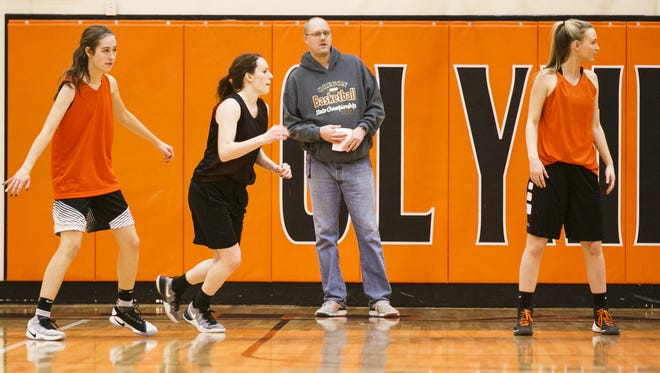 Coach Casey Williams watches players scrimmage at a practice for the Sprague High School girl's basketball team on Thursday, Jan. 12, 2017.