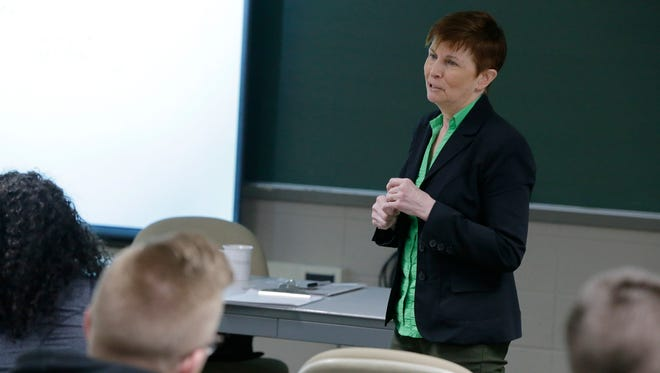 Colleen McDermott, acting dean of the University of Wisconsin-Oshkosh College of Letters & Science, teaches class Thursday, Feb. 8, 2018.
