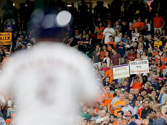 Fans hold a sign welcoming Alex Bregman (2) to the Houston Astros on Monday against the New York Yankees at Minute Maid Park.