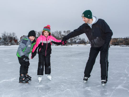 Levi Luck of Oconomowoc teaches his children Anderson, 5 and Evelyn, 7, the finer points of ice skating at the Lac La Belle ice rink in Oconomowoc in 2016.