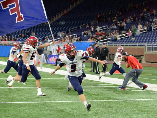 Livonia Franklin players run onto field before the