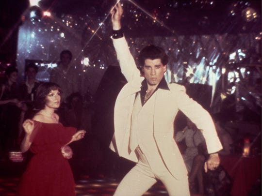 "John Travolta (center) starred in 1977's ""Saturday"